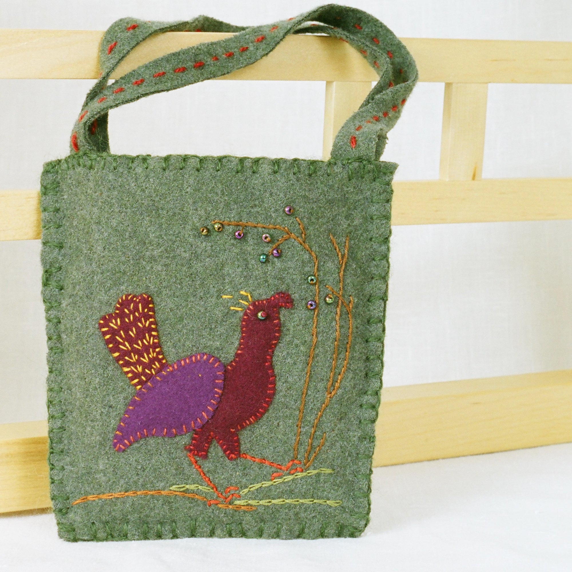 Felted wool applique bag with bird
