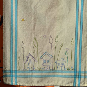 Fabrico pens drawing and stitching on kitchen towel blank