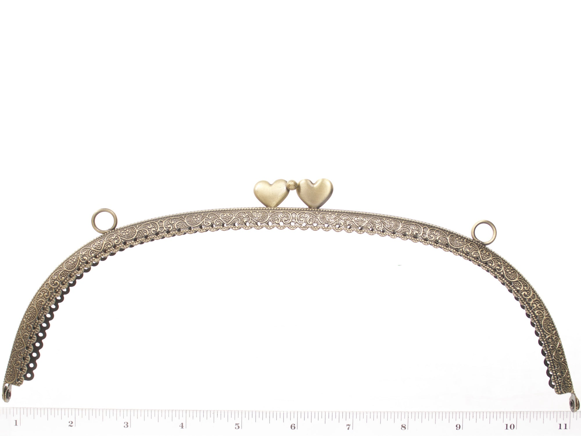 purse frame with heart clasps