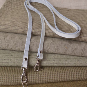 white bag strap with silves hardware