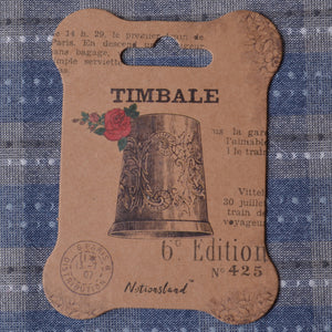 thread winder with antique thimble