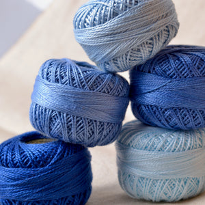Stack of blue Presencia perle cotton threads