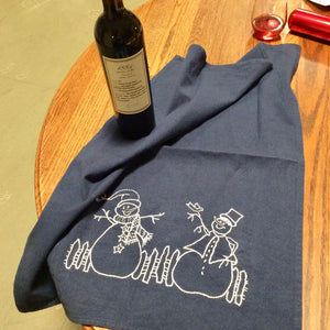 Embroidered snowmen on kitchen towel