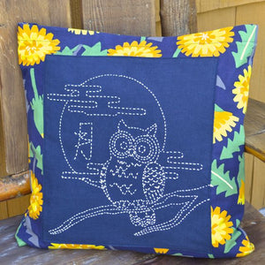 sashiko cushion with dandelion flower border