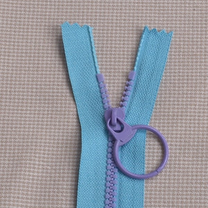 lighter blue with purple teeth zipper