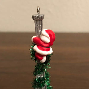 Santa on Paris Eiffel Tower Green tinsel Christmas Tree Ornament Hallmark Vintage 1995 3.5""