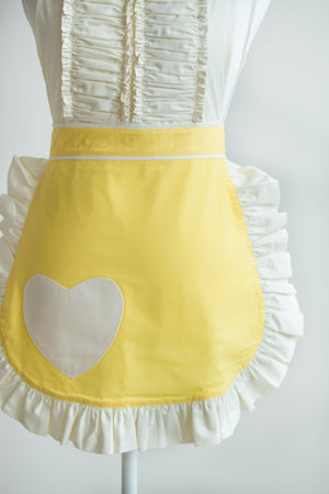 A Vintage Darling apron in yellow