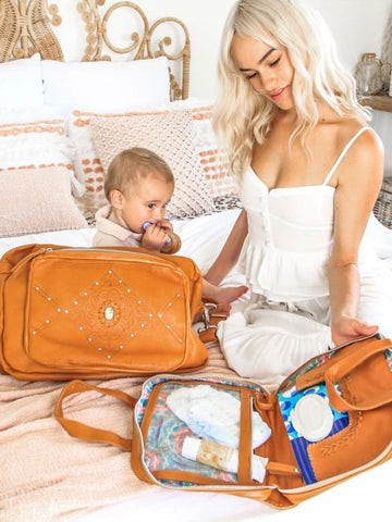 mother and baby using boho baby bag