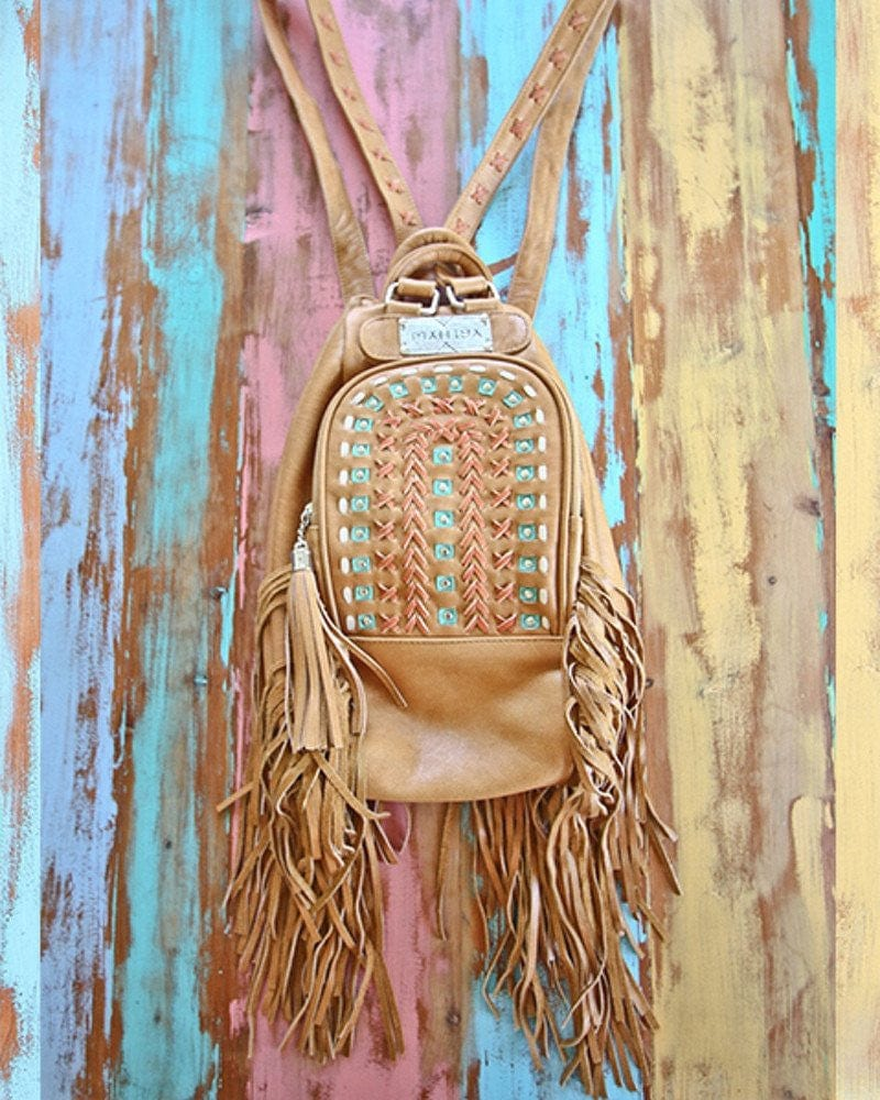 tan leather backpack purse