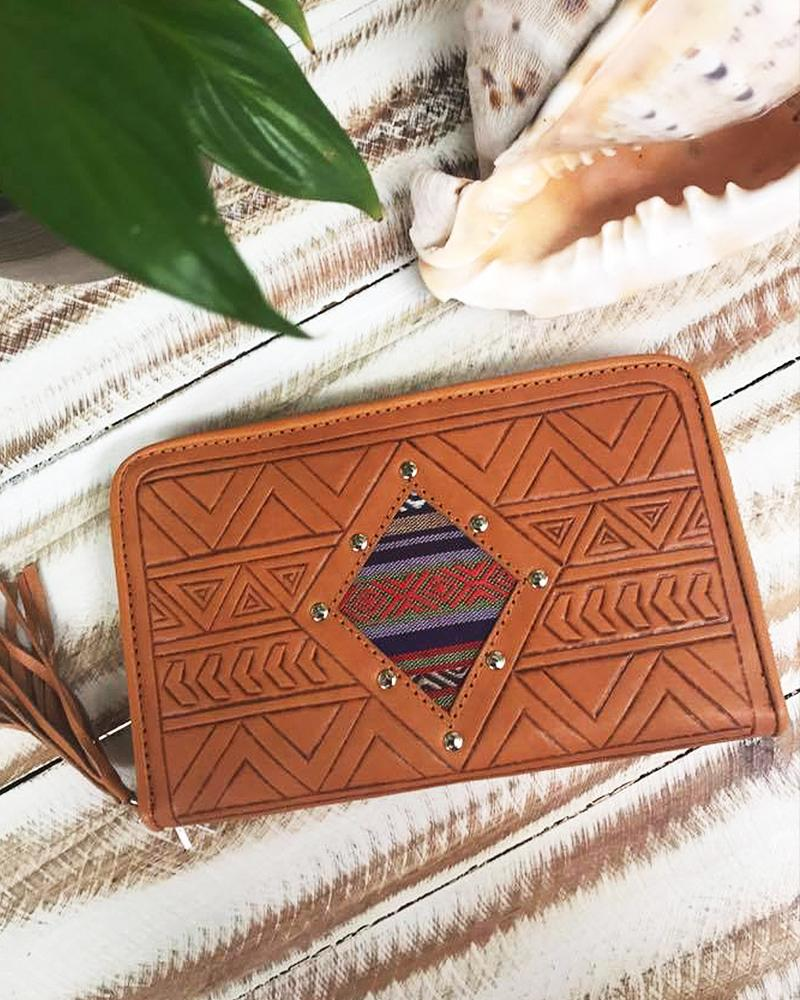 tan leather clutches