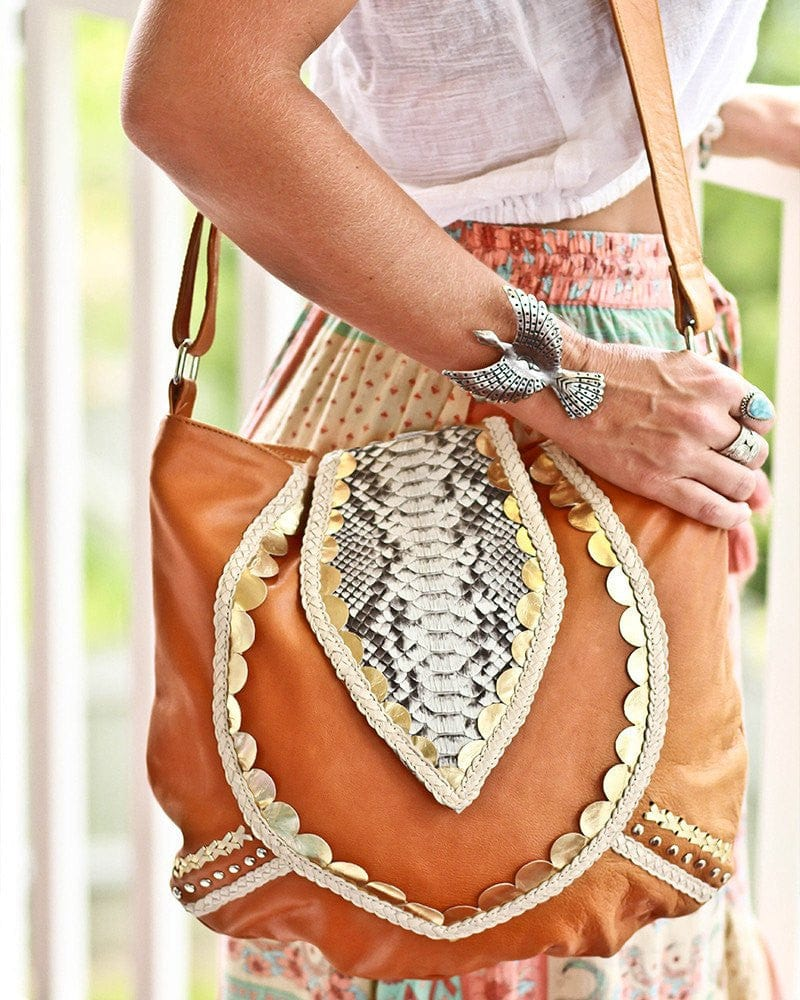 tan leather and snakeskin bags