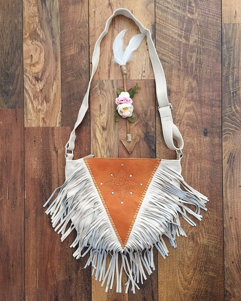 tan and white leather purse