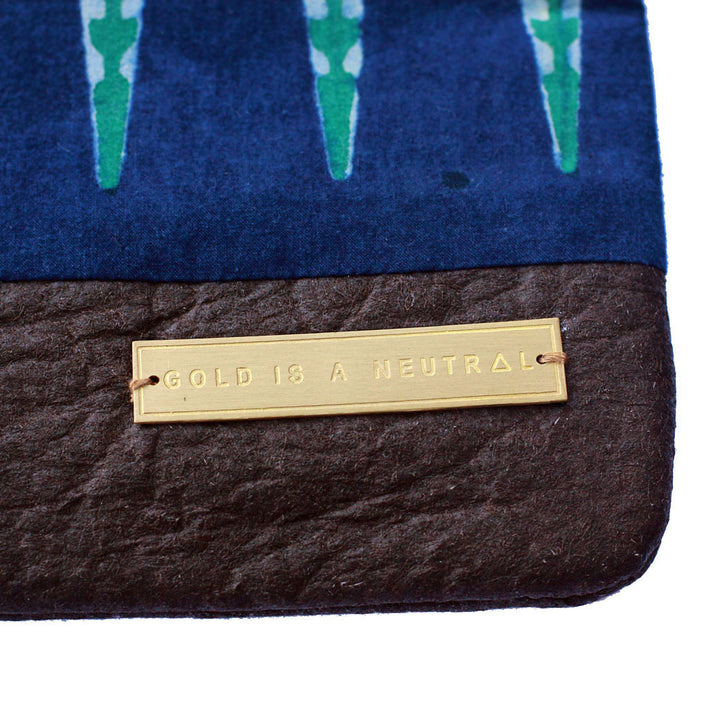 Sakina fair trade clutch bag gold tag detail