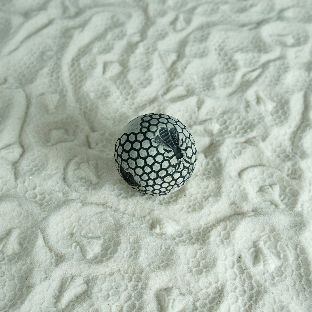Honeycomb patterned sand texture ball for sand play.