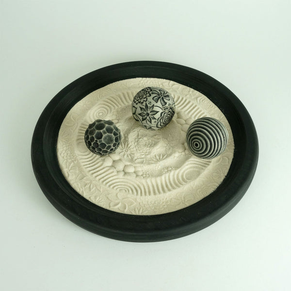 Miniature zen garden for the tabletop. It's both a beautiful, modern centerpiece & fun sand play for stress relief in one!