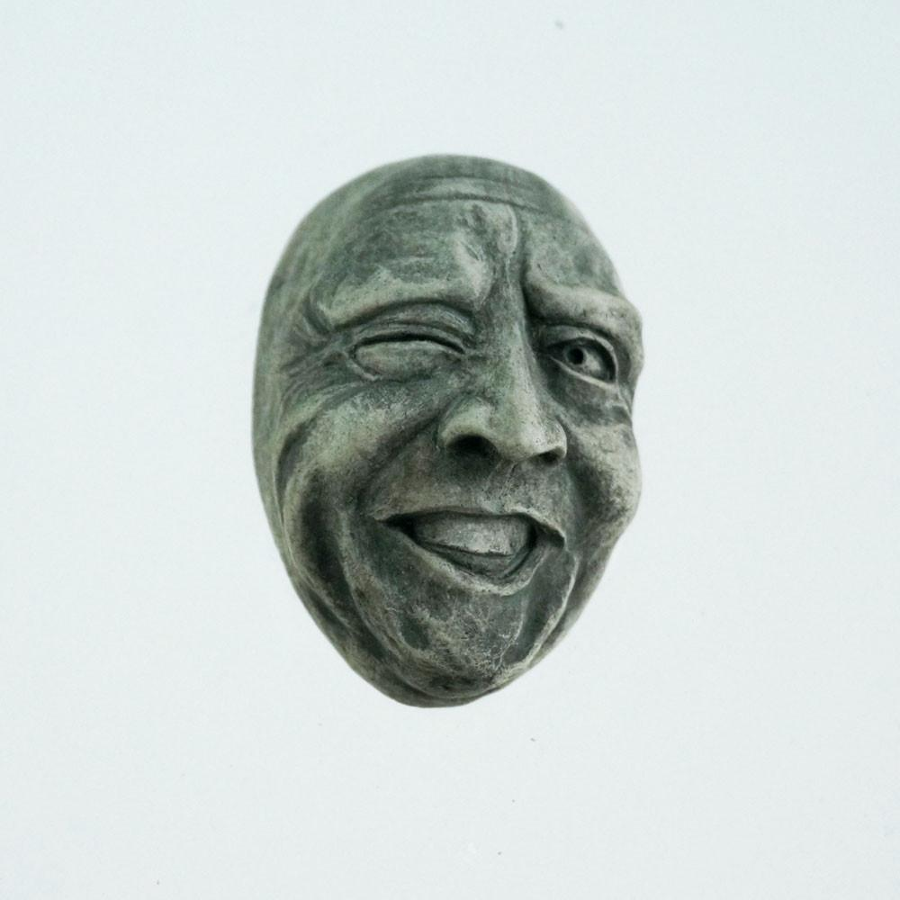 Wall-Hanging Cement Face | Wink