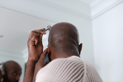 how to shave your head shave with the contours of your head with long slow strokes