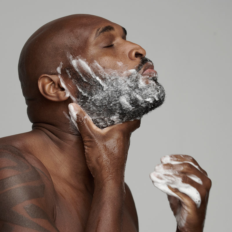 black man washing beard with frederick benjamin beard wash, best conditioning beard shampoo
