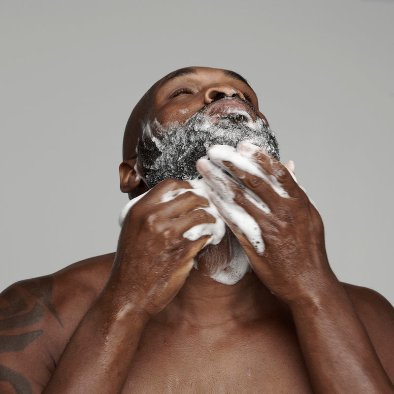 black man washing his beard with frederick benjamin beard wash