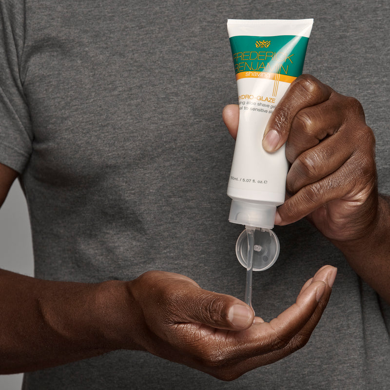 black man using frederick benjamin hydro glaze to shave face and head, best product for men of color for a comfortable shave
