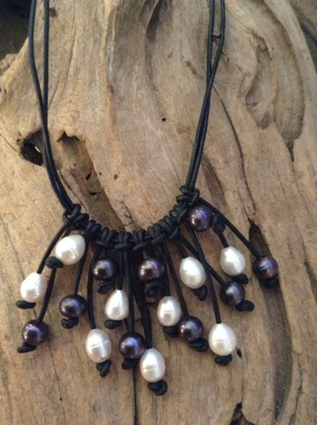 Black Peacock Pearls and White Pearls and Leather Bib Necklace