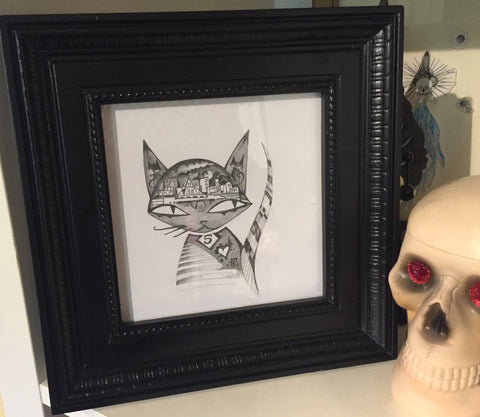 "City Kitty is an original graphite drawing by Rob Reger. Framed in a vintage black frame it measures 9"" x 9"". Signed by the artist."