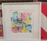 cat watercolor as described above with a large white border and white frame leaning against a shelf of records