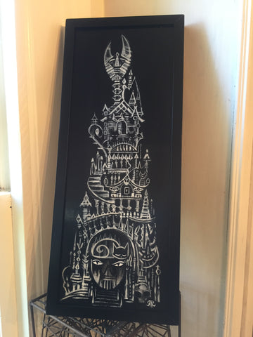 head-on photo of a painting in a simple black frame. the painting is a white-on-black image of a strange tower with a gate. shaped like Emily the Strange's face and a claw-like spire. the painting is sitting on an intricate black wire stool and leaned against a cream white wall