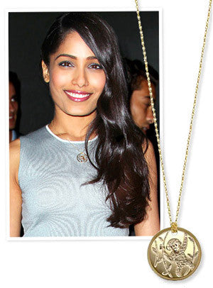 Instyle - What's Right Now! Why Freida Pinto Wears a Chimpanzee Necklace