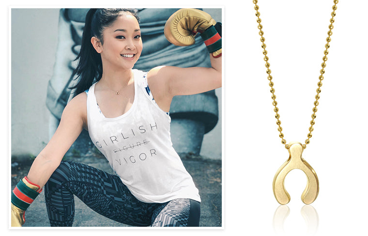 Lana Condor wearing Alex Woo Little Luck Wishbone in 14K Yellow Gold