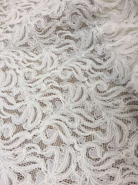 Re-embroidered lace with stretch