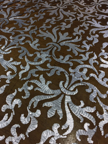 Damask Sequin in dull silver sequin on black mesh
