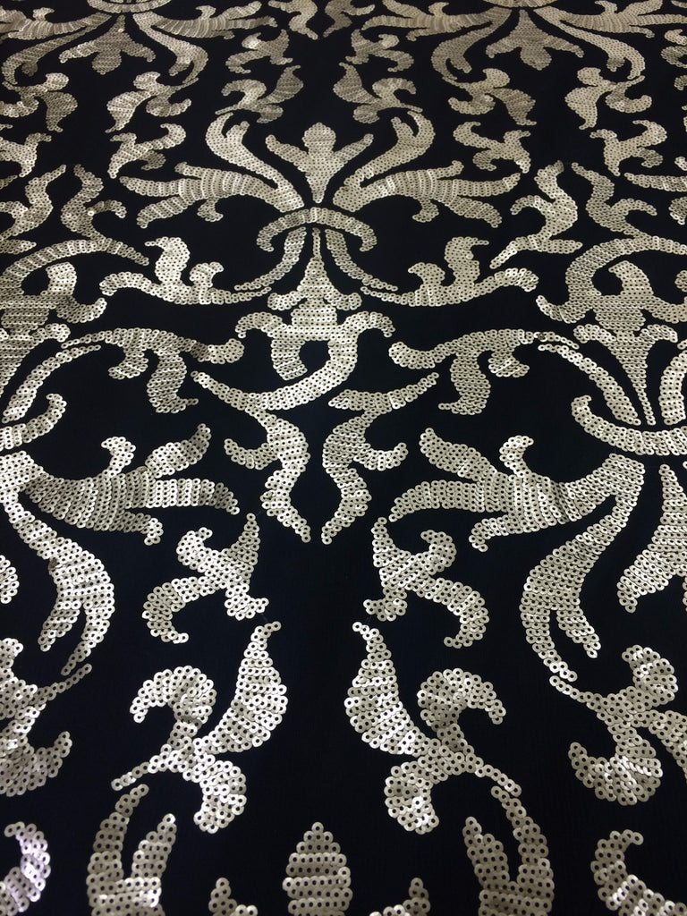 Damask Sequin in dull gold sequin on black mesh