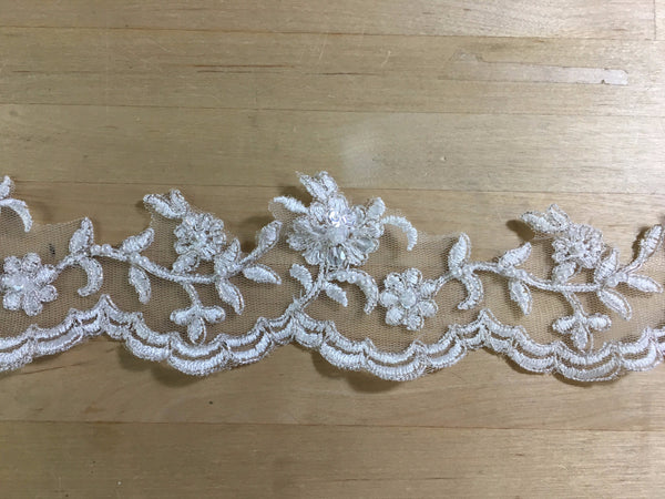Ivory Beaded Trim with Silver Metallic Re-Embroidered on net