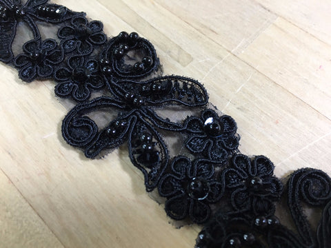 Black beaded trim on organza