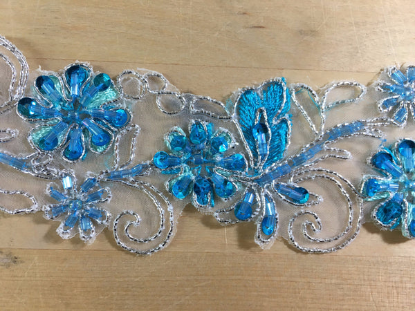 Blue beaded trim on organza with silver metallic cording