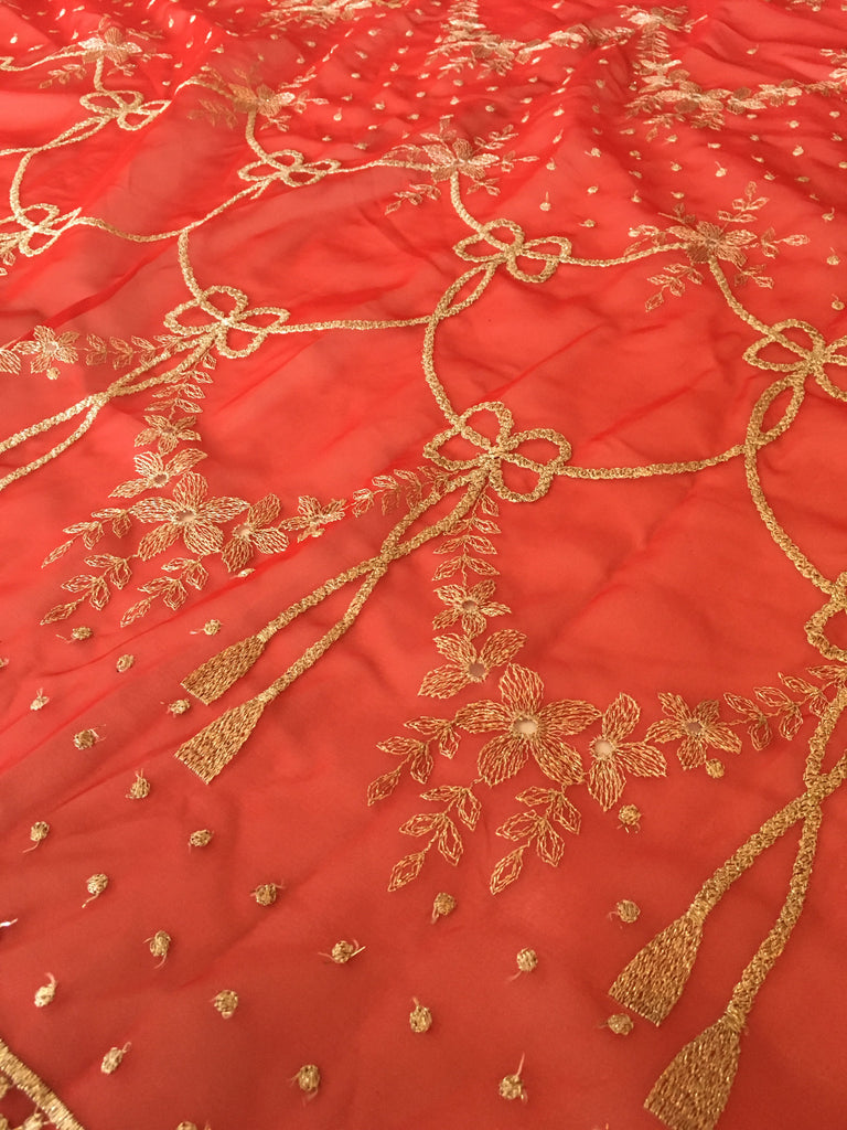 Red chiffon embellished with gold metallic embroidery
