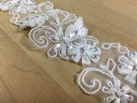 Ivory beaded trim on organza
