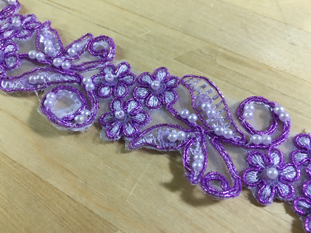 Purple beaded trim on organza