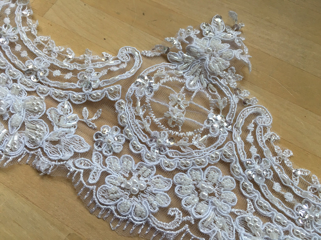 White scalloped beaded floral lace trim on net