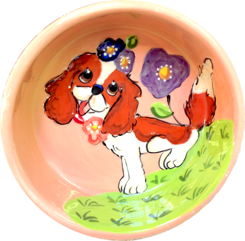 Sweet King Charles sitting in flowers | Dog Bowl
