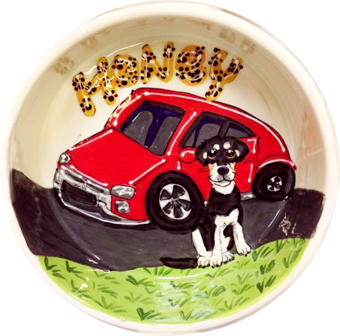 photo of black and white mix breed dog with red car on ceramic dog bowl