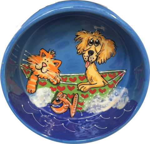Tabby cat and golden retriever smiling at fish jumping out of water while enjoying a boat ride  hand painted by Debby Carman on a ceramic bowl in whimsical pet portrait from photo on sturdy dog bowl with name of pets written around the pet bowl
