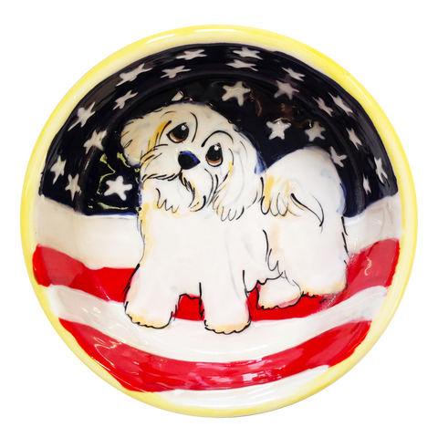 image of pet bowl with American flag design and small white dog, Shih Tzu, Maltese, maltipoo, havanese, handmade by Debby Carman, laguna beach, faux paw Artique, custom pet bowls