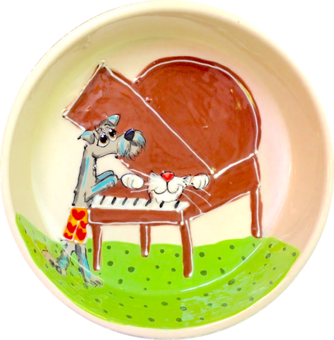 photo of dog bowl ceramic with funny dogs playing piano handmade gifts by debby carman