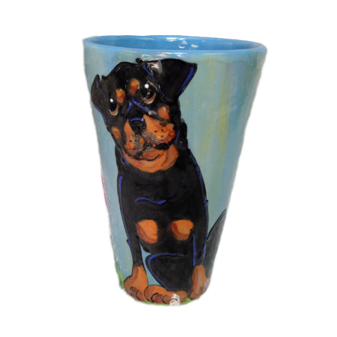 Photo of rottweiler hand painted on ceramic latte mug with blue background by Debby Carman