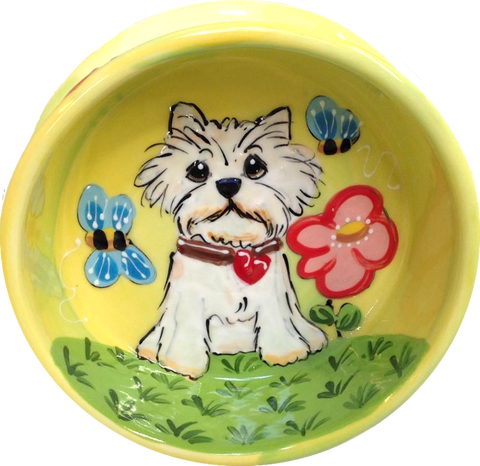 Whimsical Westie with heart charm dog collar in garden with bumble bees on yellow pretty dog bowl from Faux Paw Productions Artique Petique hand painted assorted pet bowls by Debby Carman pet boutique