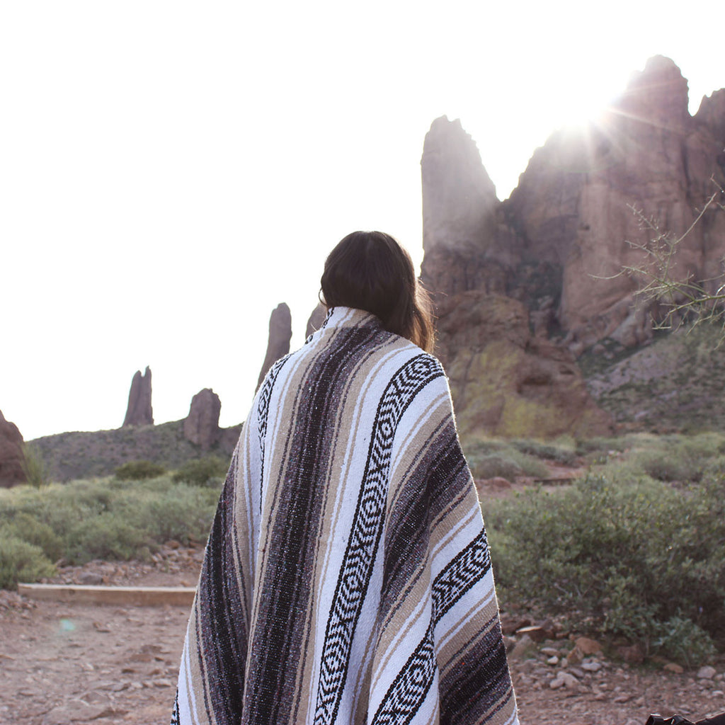 Over looking the mountains with brown mexican blanket - Campo Falsa blanket by Mntn & Moon