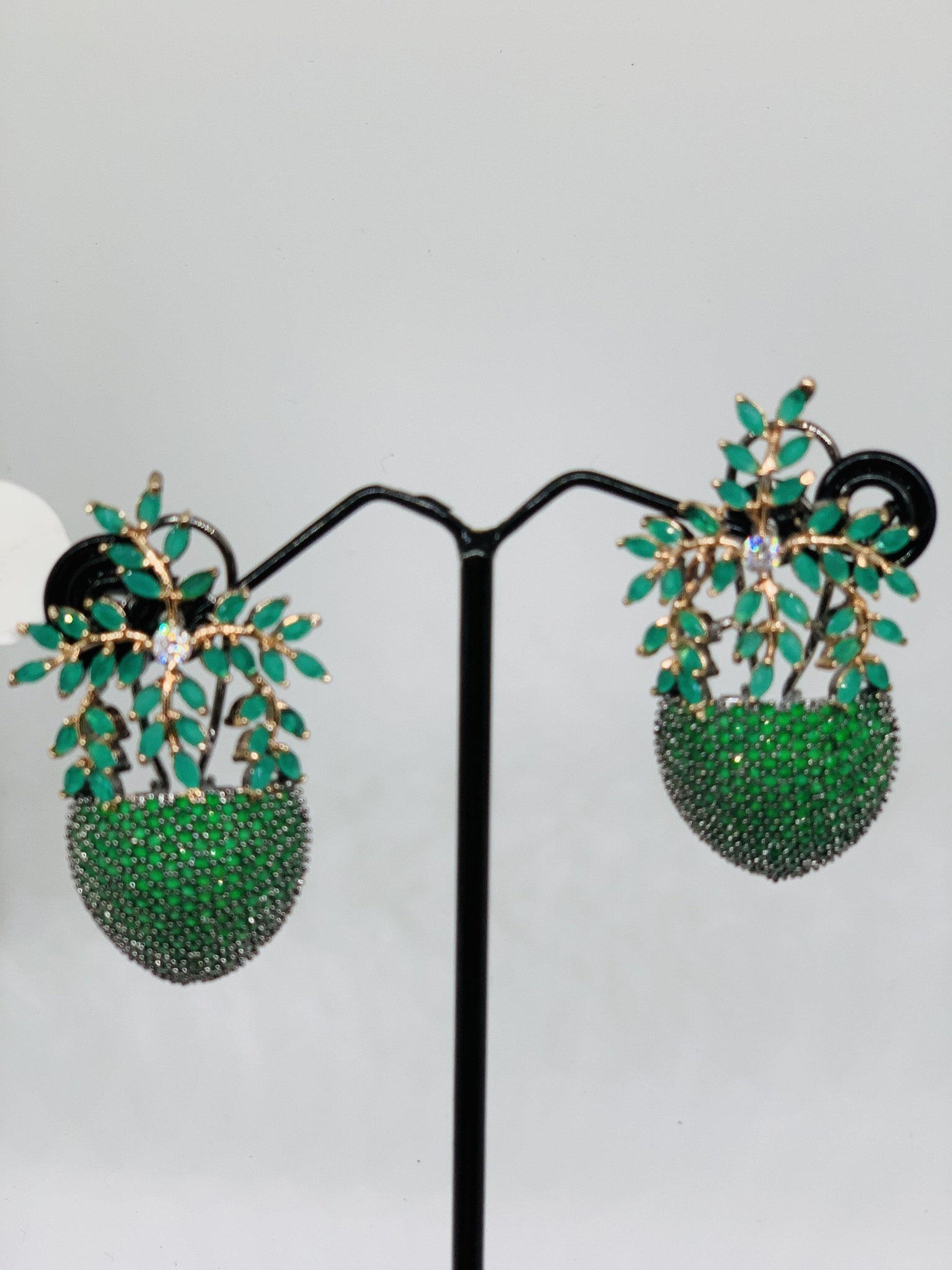 Green semi precious stone studded earrings