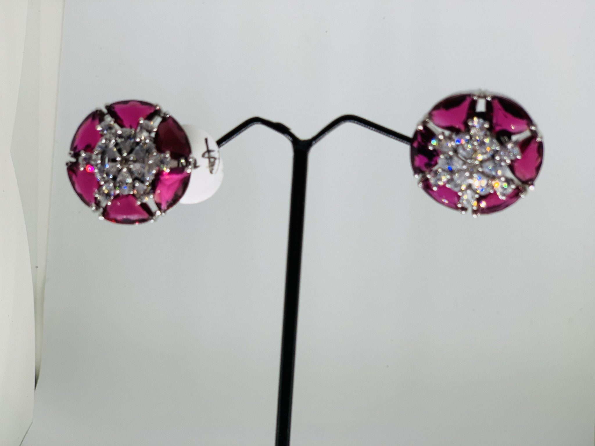 Ad studded floral red earrings
